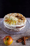 Apple cinnamon teatime cake with buttercream icing. Bee polen and apple slices stock photo