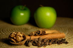 Apple, cinnamon and walnut Royalty Free Stock Photos