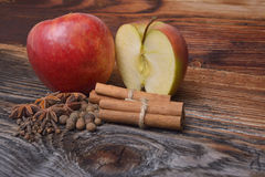 Apple with cinnamon on wood Royalty Free Stock Photo