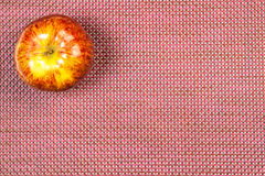 Apple on a claret background Stock Images
