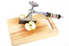 Apple cleft with kitchen axe Royalty Free Stock Photo