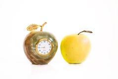 Apple and clock Stock Photos