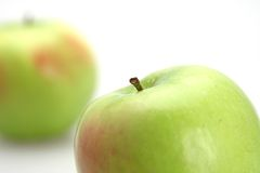 Apple Close-up. Two yellow fresh apples one focus and one out stock photo