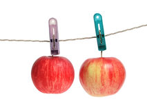 Apple on clothes peg Stock Photos