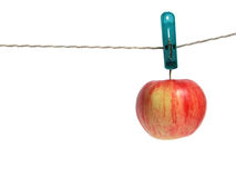 Apple on clothes peg Stock Image