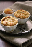 Apple cobbler. Two bowls of apple cobbler on a tin tray with apple compote Royalty Free Stock Images