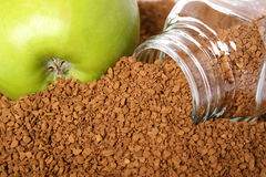 Apple and coffee. Coffee soluble in granules and a green apple Stock Photos