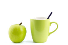 Apple and coffee mug isolated Royalty Free Stock Image