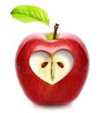 Apple com coração Fotos de Stock Royalty Free