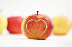 Apple com coração Fotografia de Stock Royalty Free