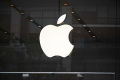 Apple company store sign logo. Portland, OR / USA - June 21 2018: Apple logo on the store on 4th avenue in downtown Portland stock photos