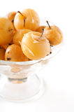 Apple compote in a glass vase on white Stock Photography