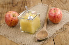 Apple compote with a spoon in a glass Stock Photos