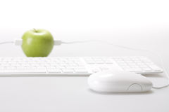Apple and computer Royalty Free Stock Photo