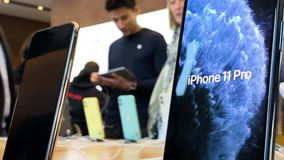 Apple Computers iPhone 11 Pro and Pro Max goes on sale. Paris, France - Sep 20, 2019: Display home screen animation on iPhone 11 Pro Max are displayed in Apple stock video