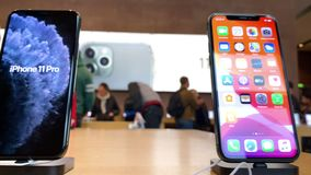 Apple Computers iPhone 11 Pro and Pro Max goes on sale. Paris, France - Sep 20, 2019: Slow panning over multiple new iPhone 11 Pro Max are displayed in Apple stock video footage