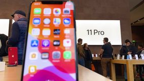 Apple Computers iPhone 11 Pro and Pro Max goes on sale. Paris, France - Sep 20, 2019: Customers in background of iPhone 11 Pro Max displayed in Apple Store as stock video footage