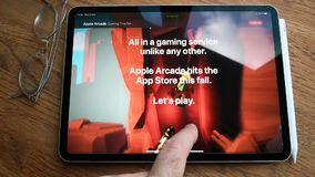 Apple Computers website featuring Arcade video game subscription service. Paris, France - Circa 2019: Man POV at the new iPad Pro with Apple.com website stock video