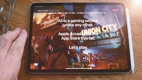 Apple Computers website featuring Arcade video game subscription service. Paris, France - Circa 2019: Time lapse fast motion Man POV at the new iPad Pro with stock video footage