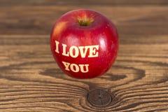 Apple con amor Foto de archivo libre de regalías