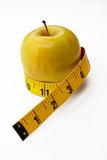 Apple con cinta métrica Fotografía de archivo libre de regalías