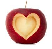 Apple con dimensión de una variable del corazón Imagenes de archivo