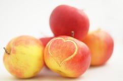 Apple con el corazón Imagen de archivo libre de regalías