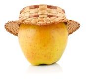 Apple con il cappello di paglia Fotografie Stock Libere da Diritti