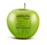 Apple con la etiqueta de los hechos de la nutrición. Foto de archivo libre de regalías
