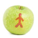 Apple con la silueta del hombre Imágenes de archivo libres de regalías