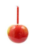 Apple con la vela del cumpleaños Imagen de archivo libre de regalías