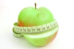Apple con nastro adesivo di misura Fotografia Stock Libera da Diritti
