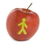 Apple con solhouette del hombre Foto de archivo