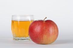 Apple con vetro Fotografia Stock Libera da Diritti