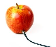 Apple connected to the cord Stock Photography