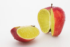 Apple containing a lemon Royalty Free Stock Photography