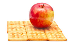 Apple and cookies. Apple on top of the pastry square isolate on a white background Royalty Free Stock Photo