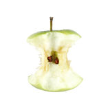 Apple core. A green apple eaten to its core showing its seeds, isolated against white stock images