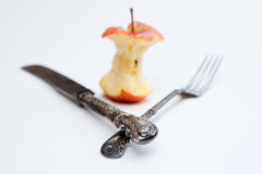 Apple core and cutlery Royalty Free Stock Photo