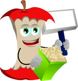 Apple core holding popcorn and blank board Stock Image