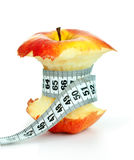 Apple core and measuring tape Royalty Free Stock Photo