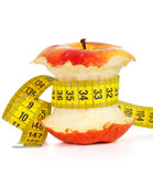 Apple core and measuring tape Stock Photography