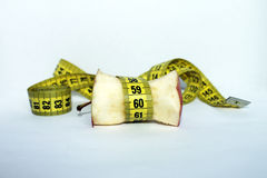 Apple core with measuring tape Stock Images