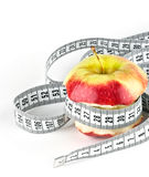 Apple core with meter Royalty Free Stock Images