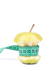 Apple core and meter Royalty Free Stock Images