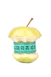 Apple core and meter Royalty Free Stock Photography