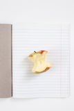 An Apple core in the open notebook in line Stock Photo