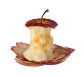Apple core and peels Royalty Free Stock Photos