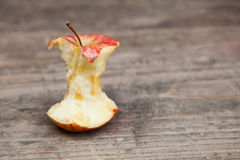 Apple core on a table Royalty Free Stock Images