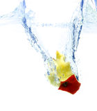 Apple core in water Royalty Free Stock Photography